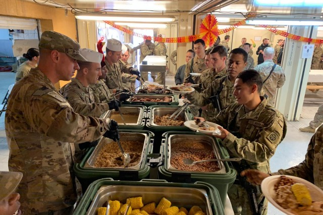 Paratroopers of the 3rd Brigade Combat Team, 82nd Airborne Division celebrate Thanksgiving in Uruzgan Province, Afghanistan on Thursday, November 28, 2019.  In keeping with tradition, senior leaders on the base served the meal while greeting the diners.