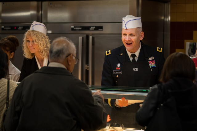 Maj. Gen. Dennis LeMaster, Regional Health Command-Pacific commanding general, and his wife, Traudi Retzlaff, both visited Madigan to serve Madigan Grille patrons, who lined up for a serving of Thanksgiving entrees and sides, as well as delivered meals to Madigan's inpatient units in the hospital tower.
