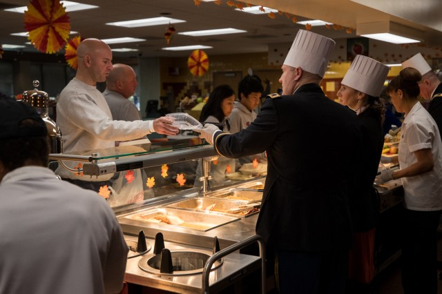 Col. Thomas Bundt, Madigan commander, who along with his wife, Elizabeth Bundt, served patrons of the Madigan Grille and delivered meals to inpatient units in Madigan's hospital tower.