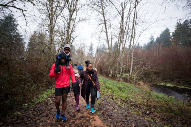 Staff Sgt. Henry Boateng-Anfom, the Troop Battalion Operations noncommissioned officer-in-charge, and his family enjoy the Murray Creek Trail portion of the route designed for Madigan Army Medical Center's inaugural Volksmarch on Joint Base Lewis-McChord, Wash., on Nov. 23.