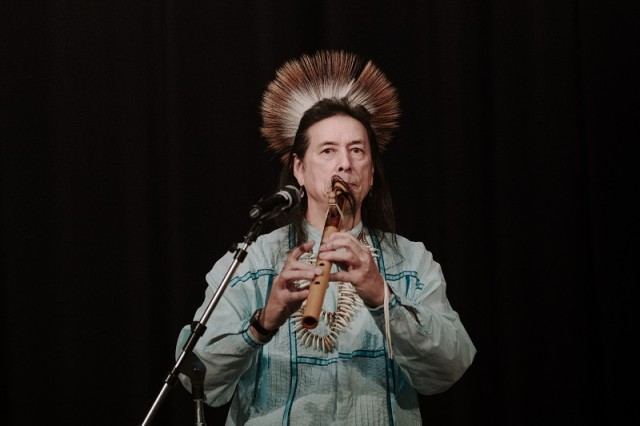 Tchin plays the flute during Picatinny Arsenal's Native American Heritage Month celebration on November 26. U.S. Army photo by Jesse Glass.