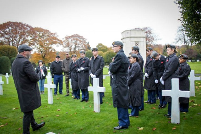 Cadets listen to Richard A. Arseneault, Flanders American Cemetery superintendent, during a visit to Ypres, Belgium Nov. 8-11 to study WWI. During the trip, they visited several historic sites reflecting the landscape were Soldiers fought. They also heard first-hand stories from people whose relatives experienced the war.