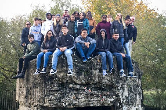The 9th Battalion Junior Reserve Officer Training Corps sit on top of an Australian bunker at Hill 60 during a visit to Ypres, Belgium Nov. 8-11 to study WWI.