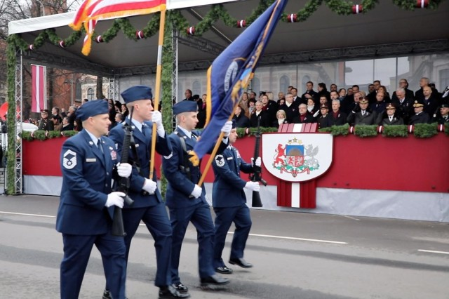Members of the Michigan Air National Guard pass the official viewing party during the Latvian Independence Day Military Parade through downtown Riga, Latvia on Monday, November 18th, 2019. The parade featured dozens of allied nation participants, including Four members of the Michigan air national guard, representing the United States. For 26 years, Latvia has been partnered with the State of Michigan in the National Guard's State Partnership Program. The State Partnership Program has been successfully building relationships for 25 years and now includes 75 partnerships with 81 nations around the globe. the State Partnership Program links state National Guard units with the armed forces, or equivalent, of a partner country in a cooperative, mutually beneficial relationship.