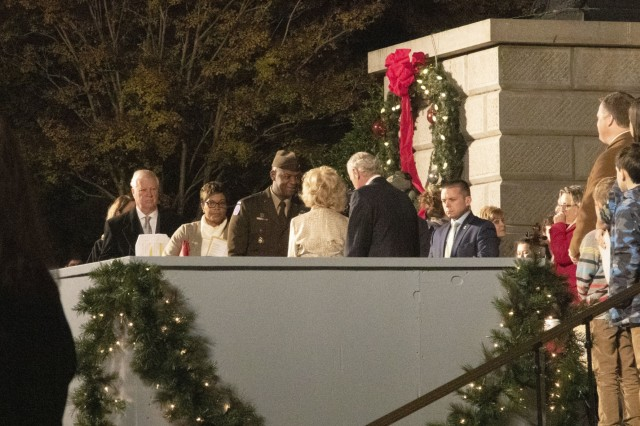 """U.S. Army Training Center and Fort Jackson Commander Brig. Gen. Milford """"Beags"""" Beagle Jr. greets S.C.  Governor Henry McMaster and his wife during the 53rd Annual Governor's Carolighting event Nov. 24 at the State House. The annual event kicks off the holiday season in Columbia, S.C."""