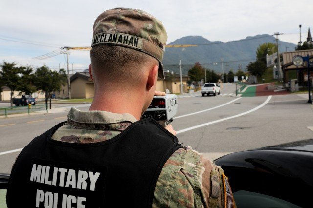 Spc. Joseph McClanahan, an MP with 401st Military Police Co., is using a radar gun to make sure vehicles are going the posted speed limit on Camp Casey, Republic of Korea, Oct. 17, 2019. The 401st MP Co. is currently attached to 3rd Armored Brigade Combat Team, 1st Cav. Div. during its rotation to the Republic of Korea. (Photo by Staff Sgt. Jacob Kohrs)