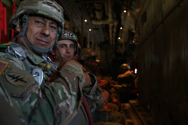 Command Sgt. Maj. Terry M. Sanchez (left), command sergeant major of the 7th Special Forces Group (Airborne), and Pvt. Diego Sanchez (right) wait to jump from a C-130J onto Fryar Drop Zone, Fort Benning, Ga. 25, Nov. 2019. The jump marked the last jump for Command Sgt. Maj. Sanchez's career and also marked the beginning of Pvt. Diego A. Sanchez, an infantryman, assigned to the 82nd Airborne Division, who was attending the U.S. Army Airborne School, and eldest son of Command Sgt. Maj. Sanchez.