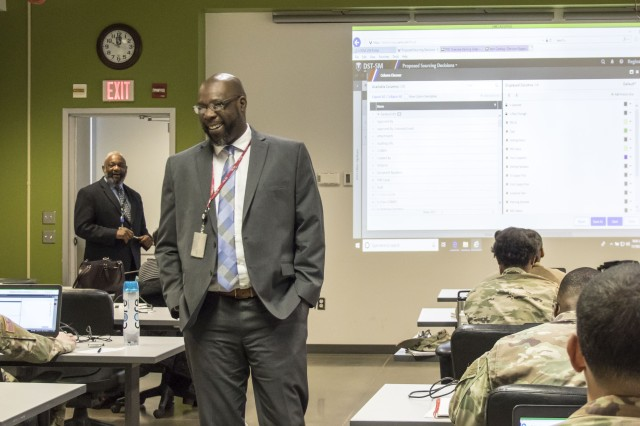 MRTD instructors, Reginald Snell and Gregg Brown, perform a check-on-learning session with students of the 101st Airborne Division.