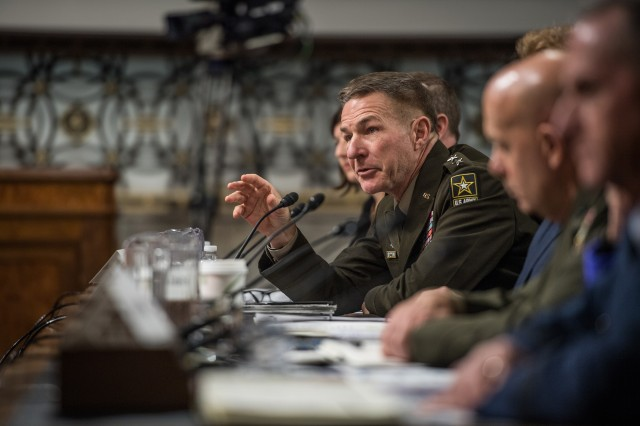 Chief of Staff of the Army Gen. James C. McConville, along with other service secretaries and chiefs, speak to the Senate Committee on Armed Services during a hearing on privatized housing in Washington D.C., Dec. 3, 2019.