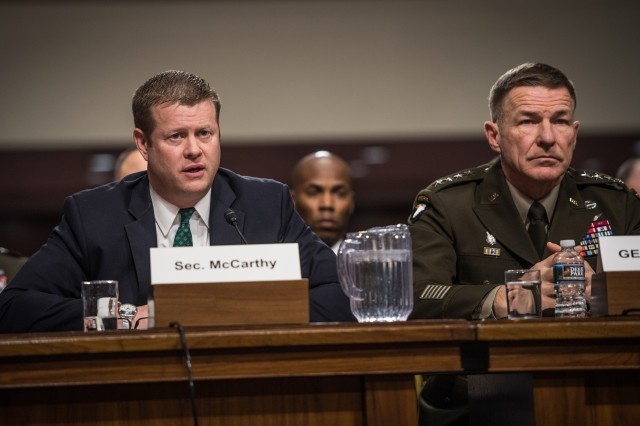 Secretary of the Army Ryan D. McCarthy and Chief of Staff of the Army Gen. James C. McConville, along with other service secretaries and chiefs, speak to the Senate Committee on Armed Services during a hearing on privatized housing in Washington D.C., Dec. 3, 2019.