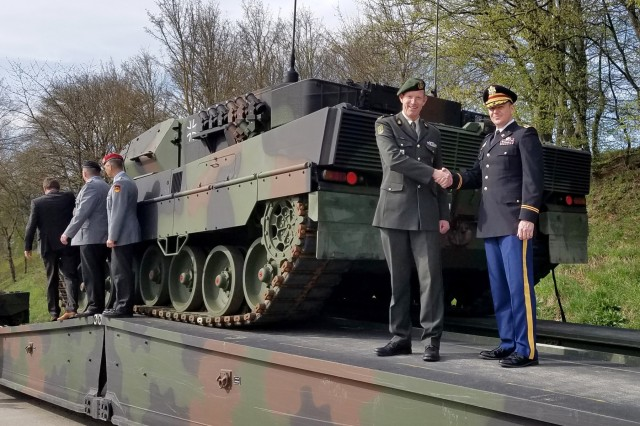 An International Technology Center director engages with the Dutch and German armies as they roll out the Leopard IIA6 FüFa, a network-enabled main battle tank with improved situational awareness for NATO missions.