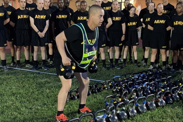 Staff Sgt. Daniel Yeates, a drill sergeant with Company D, 31st Engineer Battalion, demonstrates to trainees the proper technique for a kettlebell bent-over row. The company is piloting a new concept in physical readiness called the Strength Training Program, which is designed to reduce injuries throughout Basic Combat Training.