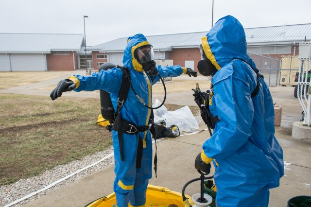 After safely exiting the tunnel system with the chemical samples, Spc. Arturo Montero is decontaminated by another CBRN specialist. Soldiers must go through a meticulous decontamination process before taking off their HAZMAT suits.