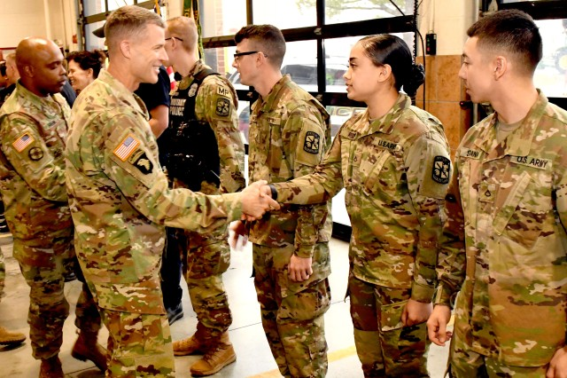 The Fort Knox garrison command team attends the badging ceremony and congratulates military policemen who earned coins of excellence from Director of Emergency Services Lt. Col. Samuel Meyer. Fort Knox Garrison Commander Col. CJ King congratulates Pfc. Samantha Roden on her accomplishment.