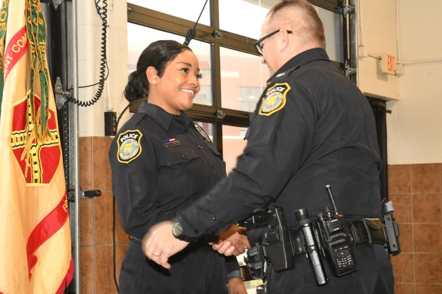 Fort Knox Chief of Police Michael Doggett congratulates newly commissioned Department of the Army Civilian Police Officer Simone Greenwade at the inaugural badging ceremony held at the Godman Army Airfield Fire Station Dec. 2, 2019.
