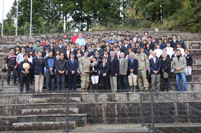 Soldiers, family members and staff assigned to U.S. Army Medical Activity -- Japan at Camp Zama, Japan, along with Japanese medical student-riders and staff pose for a group photo at the 71st annual BG Sams Equestrian Cup held Nov. 24 at Tsukui Equestrian Park.