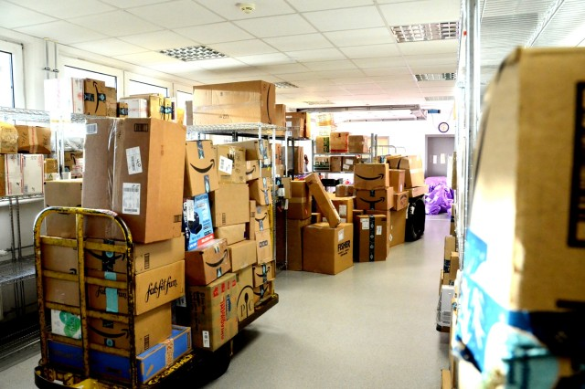 The mail room of USAG Rheinland-Pfalz Rhine Ordnance Barracks, is close to overflowing as Black Friday purchases arrived Dec. 9, the first Monday after the holiday.