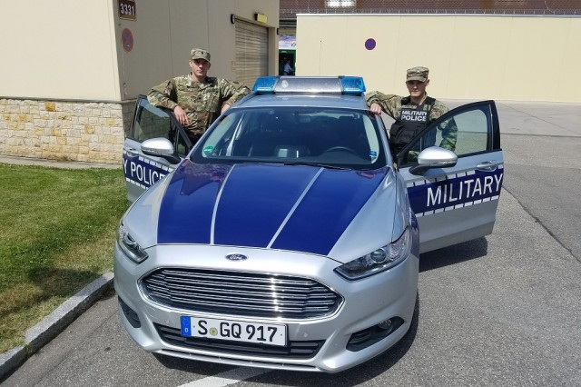 Spc. John Clark with the 1103rd Military Police Detachment - Law & Order works alongside active duty Spc. Barlow patrolling Stuttgart, Germany, June 11, 2017.
