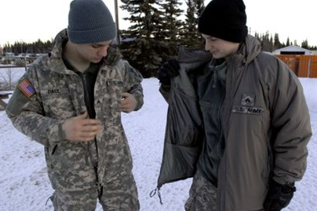 Army Sgt. Seth Paul (left) and his wife, Sgt. Katja Paul, both military police officers with the Alaska Army Guard's 49th Missile Defense Battalion at Fort Greely, call the Army's new Generation III Extended Cold Weather Clothing System the perfect answer to extreme conditions they face in Alaska. When Soldiers where fleece caps now, they can also wear the coyote brown one upon their commander's discretion.