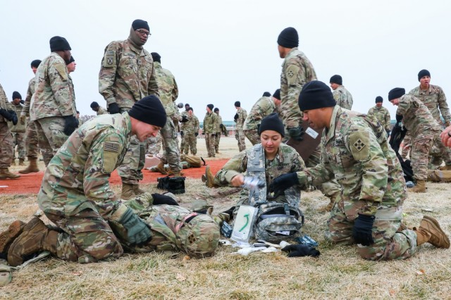 "Soldiers with 704th Brigade Support Battalion, 2nd Infantry Brigade Combat Team, 4th Infantry Division, treat a simulated casualty Nov. 7, 2019, during the battalion's ""Blacksmith Challenge,"" at Fort Carson, Colorado. The event is a monthly competition between battalions. (U.S. Army photo by Staff Sgt. Neysa Canfield)"