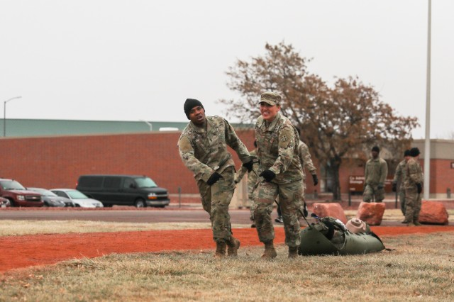 "FORT CARSON, Colo. - Two Soldiers with Charlie Company, 704th Brigade Support Battalion, 2nd Infantry Brigade Combat Team, 4th Infantry Division, pull a simulated casualty to the next event Nov. 7, 2019, at Fort Carson, Colorado, during the battalion's ""Blacksmith Challenge."" (Photo by Staff Sgt. Neysa Canfield)"