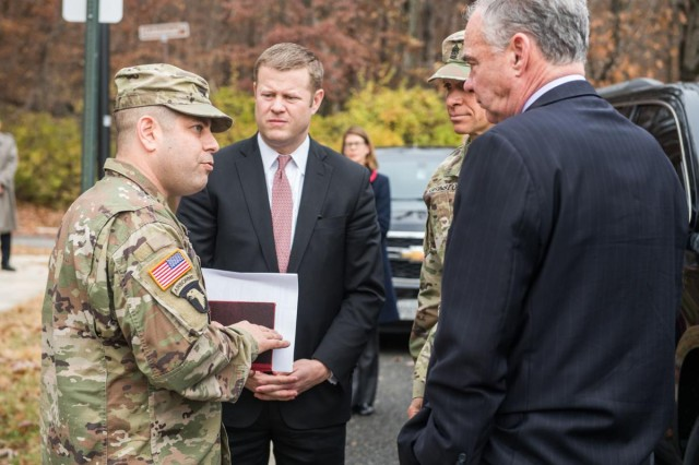 Col. Michael Greenberg, Garrison commander, discusses Fort Belvoir housing concerns with Secretary of the Army, Ryan D. McCarthy; Sgt. Maj of the Army, Michael A. Grinston; and Senator Tim Kaine (Va.), during their visit with families on Fort Belvoir, Va., Monday.