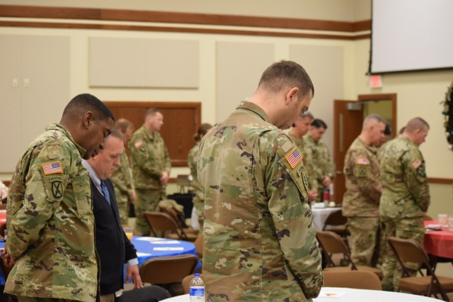 Soldiers from Mission Command Training Program (MCTP) bowing their heads during a prayer at a spiritual readiness breakfast at Frontier Chapel, Fort Leavenworth, Kansas, Dec. 4, 2019. Col. Shane Morgan, MCTP's commander, gave the keynote speech to share his personal story about how he came to value spiritual fitness as key to being a balanced person.