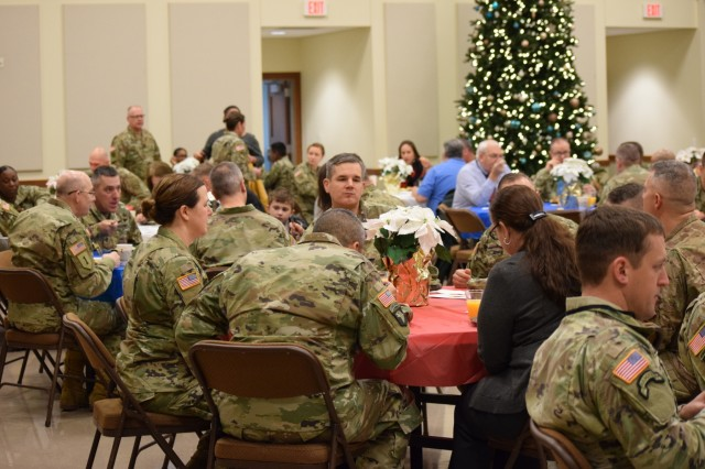 Soldiers and civilians from the Mission Command Training Program (MCTP) eating food at a spiritual readiness breakfast at Frontier Chapel, Fort Leavenworth, Kansas, Dec. 4, 2019. Col. Shane Morgan, MCTP's commander, gave the keynote speech to share his personal story about how he came to value spiritual fitness as key to being a balanced person.