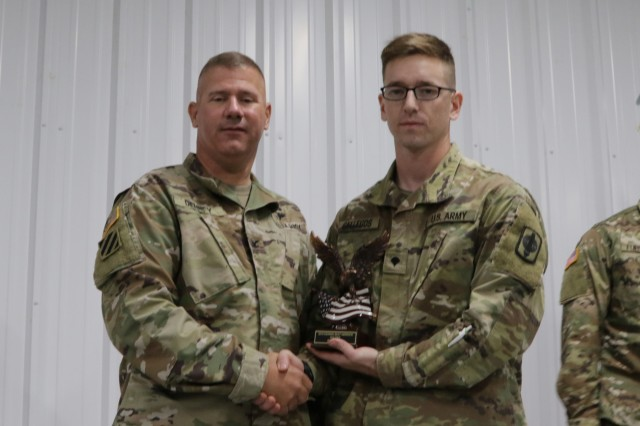 "Col. Steven Denney, director of Plans and Operations for the Kansas Army National Guard (KSARNG) presents an award to Spc. Jonathan Gallegos, a signal support systems specialist assigned to the 330th Signal Company, 997th Brigade Support Battalion, 130th Field Artillery Brigade, for placing first as ""Best Soldier of The Year"" at the 2019 annual KSARNG Best Warrior Competition that took place at the Great Plains Joint Training Center in Salina, Kansas, Oct. 31-Nov. 3, 2019. Competitors completed an Army Physical Fitness Test, day and night land navigation, weapons qualification, an Air Assault obstacle course, a call for fire exercise and a ruck march. Additionally, they tested on the new Army Combat Fitness Test."