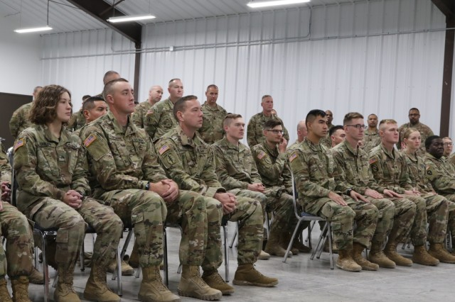 SALINA, Kan- Competitors for the Soldier and Non-commissioned Officer of The Year at the 2019 annual KSARNG Best Warrior Competition that took place at the Great Plains Joint Training Center in Salina, Kansas, Oct. 31-Nov. 3, 2019, listen for the winner's names to be called off during the closing ceremony. Competitors completed an Army Physical Fitness Test, day and night land navigation, weapons qualification, an Air Assault obstacle course, a call for fire exercise and a ruck march. Additionally, they tested on the new Army Combat Fitness Test.