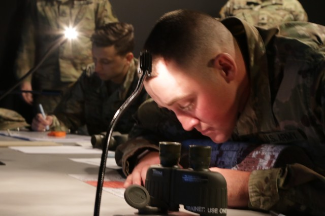 Sgt. Luke Fursman, a horizontal construction engineer assigned to the 242nd Engineering Company, 891st Engineer Battalion, 635th Regional Support Group, completes the steps for call for fire in the simulator at Fort Riley, Kansas, during the 2019 annual KSARNG Best Warrior Competition Nov. 2, 2019. Competitors completed an Army Physical Fitness Test, day and night land navigation, weapons qualification, an Air Assault obstacle course, a call for fire exercise and a ruck march. Additionally, they tested on the new Army Combat Fitness Test.