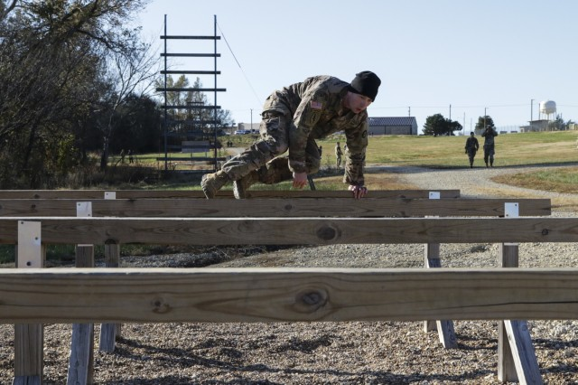 Sgt. Travis Warren, a multi-channel transmission systems operator-maintainer assigned to Headquarters and Headquarters Company, 1st Battalion, 108th Aviation Regiment, 635th Regional Support Group, jumps over the 'six vaults' on one of the obstacles on an Air Assault obstacle course at Fort Riley, Kansas, during the 2019 annual KSARNG Best Warrior Competition Nov. 2, 2019. Competitors completed an Army Physical Fitness Test, day and night land navigation, weapons qualification, an Air Assault obstacle course, a call for fire exercise and a ruck march. Additionally, they tested on the new Army Combat Fitness Test.