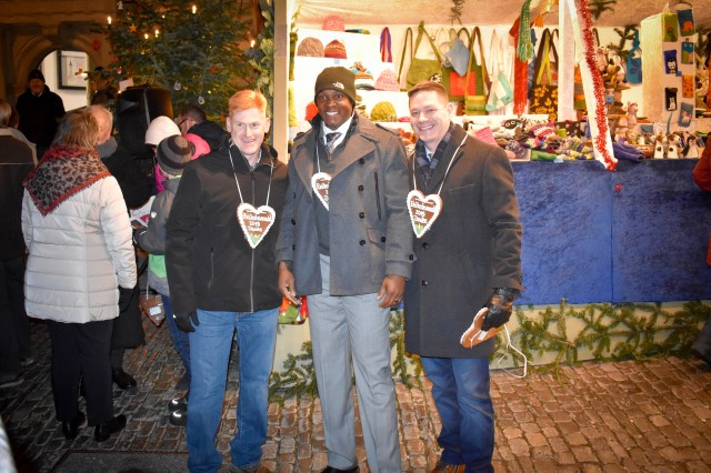 Left, Col. John Broam, 12th Combat Aviation Brigade commander; Command Sgt. Maj. Philson Tavernier, U.S. Army Garrison Ansbach; and Col. Steven M. Pierce, USAG Ansbach commander, take part in Rothenburg ob der Tauber's Christmas festivities Dec. 5, after listening to the Ansbach Elementary School choir perform.