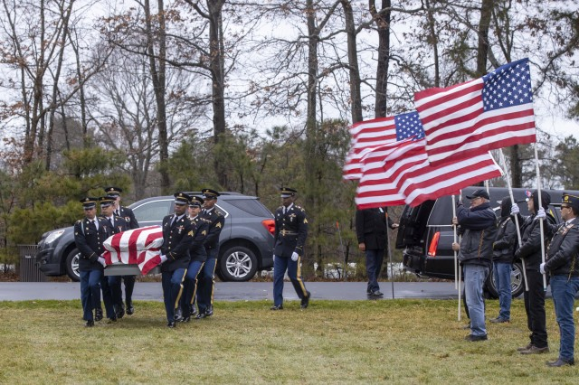 Members of the New York Military Forces Honor Guard provide military honors for the funeral service of former Army paratrooper Pvt. Needham Mayes at Calverton National Cemetery, N.Y., Dec. 2, 2019. Mayes, 85, a Soldier dishonorably discharged from the Army in 1955 after a bar fight, had his discharge upgraded to honorable and was buried, today, with his comrades-in-arms.