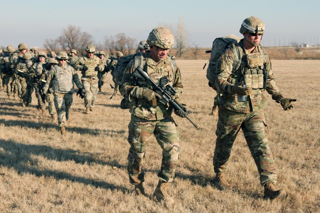 Sgt. Maj. of the Army Michael A. Grinston (with M4 rifle) walks with a platoon of basic combat trainees and drill sergeants from B Battery, 1st Battalion, 19th Field Artillery, Dec. 6, 2019, at Fort Sill, Oklahoma. The trainees were in Week 8 of BCT.