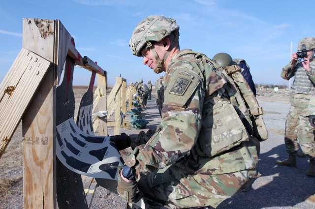 Sgt. Maj. of the Army Michael A. Grinston checks out the groupings on his target after firing an M4 rifle with basic combat trainees Dec. 6, 2019, at Fort Sill's 25 Meter II Range. Grinston visited the post to learn about the Basic Combat Training, field artillery, and air defense artillery training missions.