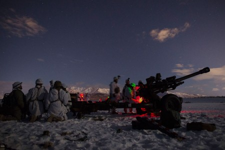 Army paratroopers set up a M119 105 mm howitzer at Malemute Drop Zone while conducting an airborne forced entry operation at Joint Base Elmendorf-Richardson, Alaska, Jan. 16, 2019. Paratroopers from 377th Parachute Field Artillery Regiment, 4th Infantry Brigade Combat Team (Airborne), 25th Infantry Division, conducted an airborne forced entry operation and follow on live-fire exercise while elements from the 6th Brigade Engineer Battalion acted as opposition forces. (U.S. Air Force photo by Alejandro Peña)