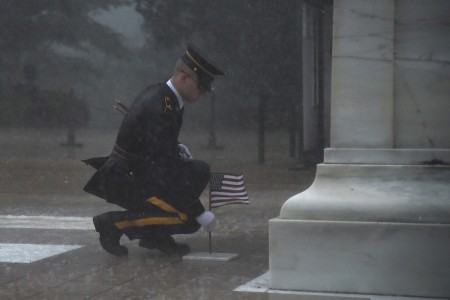 A Soldier of the 3d U.S. Infantry Regiment (The Old Guard) plants a U.S. flag in front of the Tomb of the Unknown Soldier during a severe storm for Flags In at Arlington National Cemetery, Arlington, Va., May 23, 2019. Flags In is an annual military operation carried out by The Old Guard before Memorial Day weekend in which Soldiers plant over 245,000 U.S. flags at the graves of Arlington National Cemetery. (U.S. Army photo by Sgt. Maryam Treece)