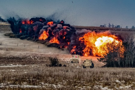 U.S. Soldiers with the 91st Engineer Battalion, 1st Armored Brigade Combat Team, 1st Cavalry Division, detonate a mine clearing line charge fired from their M1 assault breacher vehicle at the Camp Aachen training area, Grafenwoehr, Germany, Jan. 23, 2019. (U.S. Army National Guard photo by Spc. Jacob Hester-Heard)