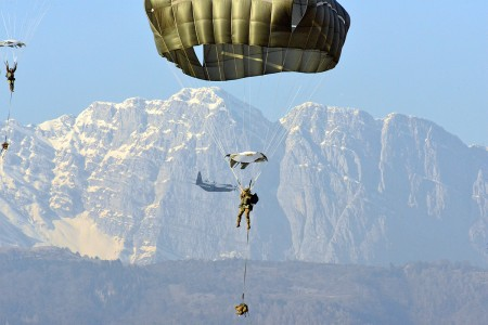 U.S. Army Paratroopers descend onto Juliet Drop Zone after exiting a U.S. Air Force C-130 Hercules aircraft from the 86th Air Wing during airborne operations in Pordenone, Italy, Feb. 13, 2019. The 173rd Airborne Brigade is the U.S. Army Contingency Response Force in Europe, capable of projecting ready forces anywhere in the U.S. European, Africa or Central Commands' areas of responsibility. (U.S. Army photo by Davide Dalla Massara)