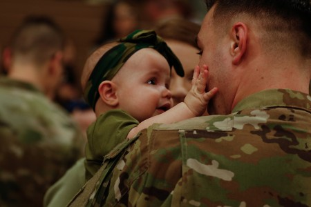 "Six-month-old Emma reacts to seeing her dad, Spc. Jacob Debbery, Company B, 404 Aviation Support Battalion, 4th Combat Aviation Brigade, 4th Infantry Division, returning home from a deployment, following a homecoming ceremony at the William ""Bill"" Reed Center, Fort Carson, Colo., March 9, 2019. The 4th CAB deployed to Europe as part of the regionally allocated forces supporting Operation Atlantic Resolve. (U.S. Army photo by Sgt. Daphney Black)"