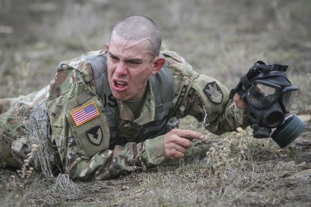 "An Army Reserves Soldier low crawls to avoid ""enemy fire"" after spending several long minutes inside a gas chamber during a joint command Best Warrior competition at Camp Williams, Utah, March 22, 2019. Nearly 20 Soldiers from around the country came together to compete in four-days of intense challenges ranging from 12-mile ruck marches, to weapons marksmanship, drill and ceremony, written essays, day and night land navigation and a host of basic Soldiering skills as they vie to rise above their competitors and claim the title of their command's Best Warrior. (U.S. Army Reserve photo by Sgt. 1st Class Brent C. Powell)"