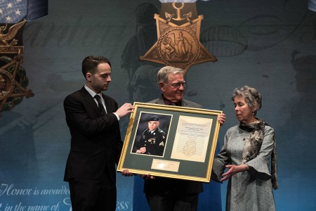U.S. Army Staff Sgt. Travis Atkins posthumously inducted into the Pentagon's Hall of Heroes during a ceremony with the Atkins' Family at the Pentagon in Washington, D.C., March 28, 2019. The induction will add Atkins' name to the in the Hall of Heroes, the Department of Defense's permanent display of record for all recipients of the Medal of Honor. (DOD photo by U.S. Army Sgt. Amber I. Smith)