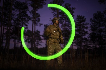 "A Soldier with 20th Special Forces Group (Airborne) demonstrates the proper use of a ""buzzsaw,"" which can be used for signaling purposes during a live-fire training event at the Camp Shelby shoothouse, Jan. 21, 2019. The training gave members the opportunity to train on breaching and clearing an enemy-held house while using live ammunition. (U.S. Air National Guard photo by Staff Sgt. Christopher S. Muncy)"