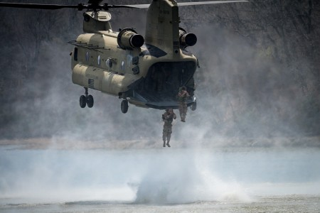 U.S. Army Sappers leap out of a Chinook helicopter into the Lake of the Ozarks during a helocast exercise at the 13th Annual Lt. Gen. Robert B. Flowers Best Sapper Competition on Fort Leonard Wood, Mo., April 8, 2019. (U.S. Army photo by Spc. Justin W. Stafford)