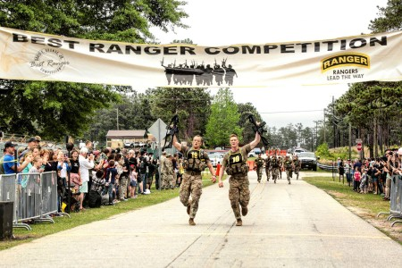 Capt. John Bergman and Capt. Michael Rose, with 101st Airborne Division (Air Assault), win the 2019 Best Ranger Competition at Fort Benning, Ga., April 14, 2019. After two full days and nights of events to test stamina, technical prowess and mental acuity, 16 teams crossed the finish line. (U.S. Army photo by Patrick Albright)
