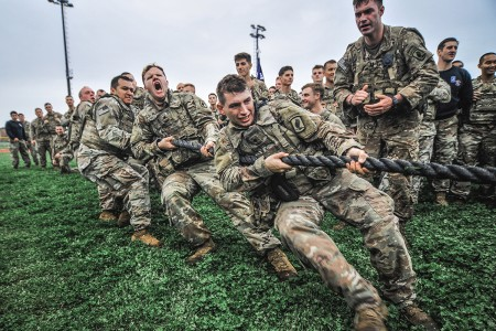 U.S. Army paratroopers compete in a tug-o-war while participating in physical fitness event to start the brigade's Team Day at Caserma Del Din, in Vicenza Italy, April 26, 2019. Team Day is an opportunity to help different clubs, organizations and teams from the Vicenza community, who have positive, healthy goals, meet people with similar interests and bring them into their team. (U.S. Army photo by Sgt. Henry Villarama)