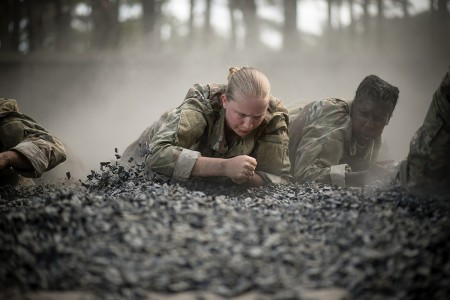 "Trainees of Charlie Company, 2nd Battalion, 60th Infantry regiment low crawl toward the finish line of the ""Fit To Win"" endurance course during week 2 of basic combat training at Fort Jackson, SC. The installation trains 50 percent of the U.S. Army's basic combat training load and more than 60 percent of all women entering the Army each year. (U.S. Army photo by Saskia Gabriel)"