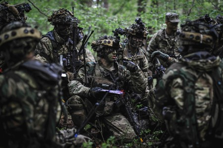A 173rd Airborne Brigade Paratrooper gives directions to his troops while participating in Immediate Response 2019 at Pocek Training Area, Slovenia, May 15, 2019. Immediate Response 2019 is a multinational exercise co-led by Croatian armed forces, Slovenian armed forces, and U.S. Army Europe. (U.S. Army photo by Sgt. Henry Villarama)
