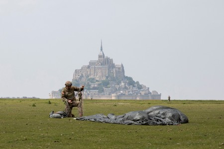 A paratrooper assigned to the U.S. Army's 10th Special Forces Group (Airborne) conducts an airborne operation near the island of Mont Saint Michel, Avranches, France, May 18, 2019. This event comes at the invitation of the Mayor of Avranches in commemoration of World War ll special operations that laid the success for the Allied liberation of France, and a celebration of the strong alliance between France and the United States. (U.S. Army photo by Sgt. Alexis K. Washburn)